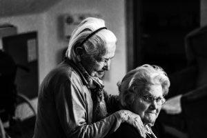 Older women dancing or sitting